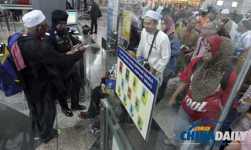 失联客机乘客身份_马来西亚机场加强乘客身份检查力度[1]- 中国日报网