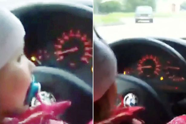 坐在宝马车里的照片_马路惊魂!俄两岁女孩坐在爸爸腿上驾车妈妈在旁哈哈大笑